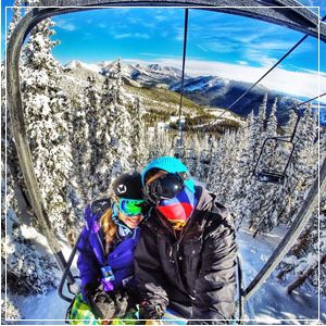 Two chairlift riders posing for a selfie.