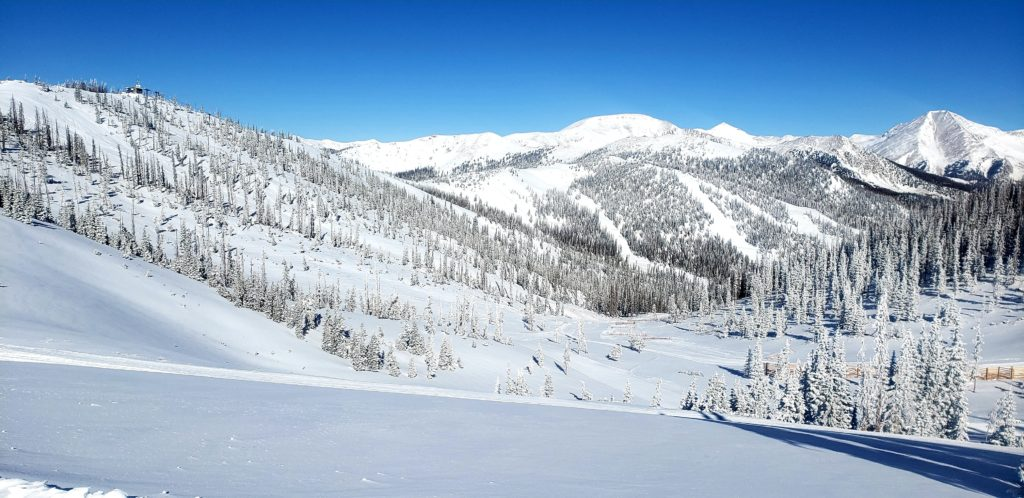 Snow covered terrain and Blue Skies!