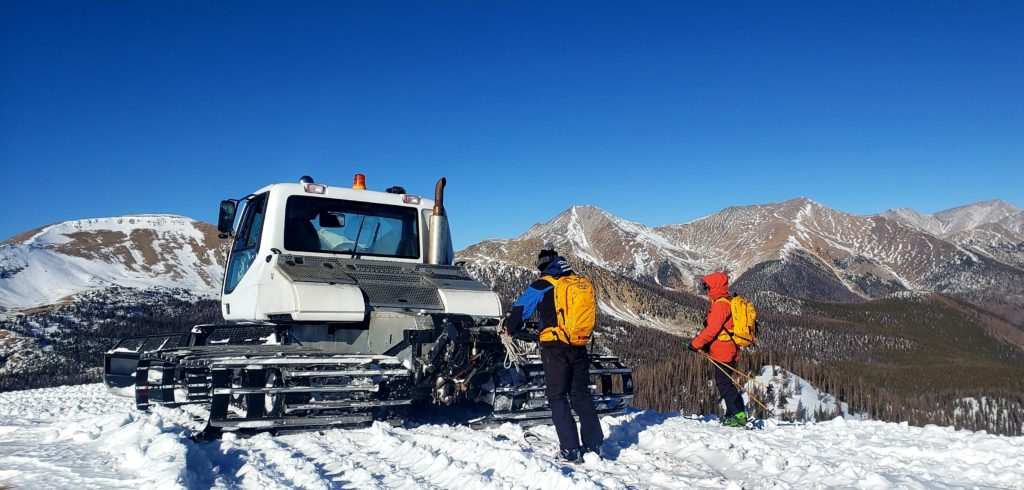 Snowcat and guides on top
