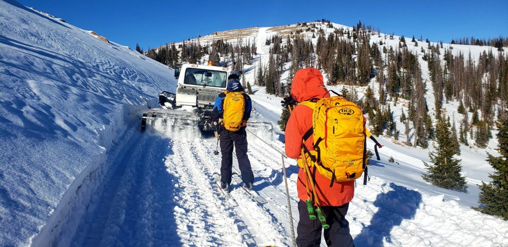 MCS Guides towing up behind snowcat