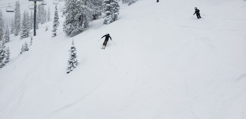 skiers on examiner